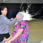 Raffle Winner, 5th Grader Ava Wanker, pies Principal Jorgenson in the face at the May 5th School Assembly